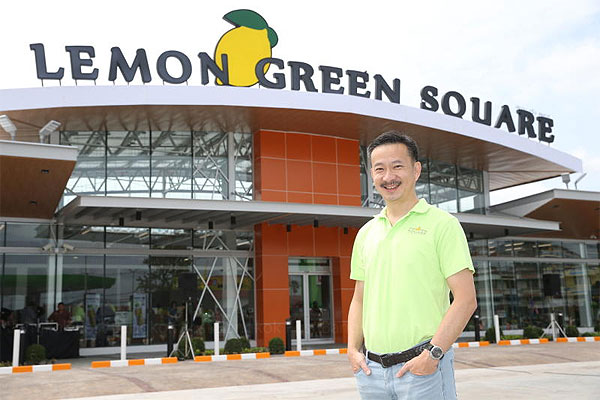 Bangchak president Chaiwat Kovavisarach stands in front of the Lemon Green Square branch in Phetchaburi's Cha-am district. The new retail concept will serve as a prototype for 400 Bangchak stations nationwide by 2020.