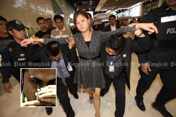 Jiang Sulian, 39, a Chinese woman who stole and swallowed a six-carat diamond worth 10 million baht allowed doctors with surgical pliers to go in and retrieve it during a 12-minute operation on Sunday. (Photos by Pornprom Satrabhaya)