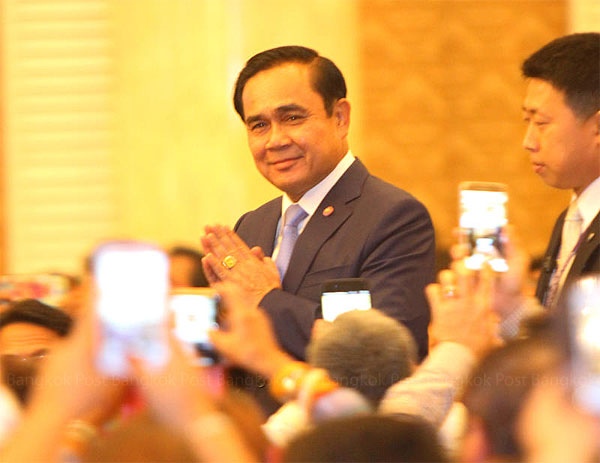 Prime Minister Prayut Chan-o-cha vows to place importance on promoting small and medium-sized enterprises to play a major role in driving the Thai economy at an event organised by the Industry Ministry yesterday. TAWATCHAI KEMGUMNERD