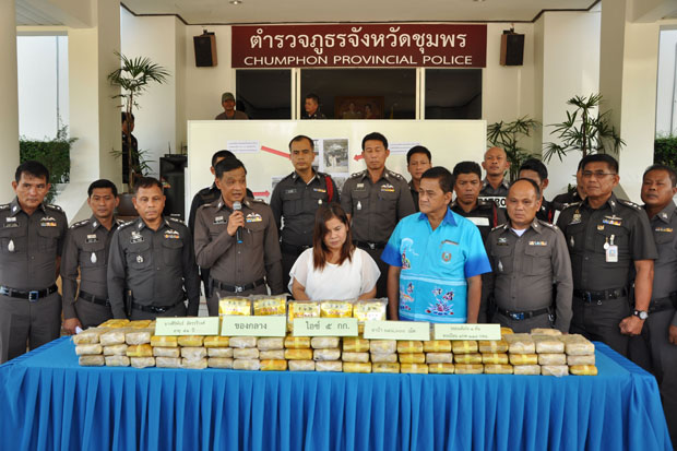 Authorities in Chumphon province show Siriphan Chatraweewong, 51, with the illicit drugs that she allegedly trafficked at a press conference on Tuesday. (Photo by Amnart Thongdee)