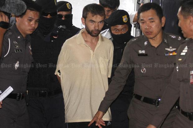 Bombing suspect Adem Karadag (centre) is seen in this file photo taken at Min Buri court in Bangkok in early September. (Photo by Thanarak Khunton)