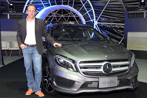 Martin Schulz, vice-president for sales and marketing at Mercedes-Benz (Thailand), poses with a new GLA. The GLA and CLA models are now made locally, allowing them to be priced at an affordable level for young customers.