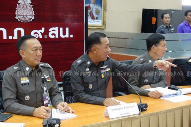 Deputy police chief Aek Angsananont, centre, led the investigations of trafficking of Rohingya migrants from Myanmar and Bangladesh after the discovery in April of mass graves in several locations in the South. (File photo by Wichayant Boonchote)
