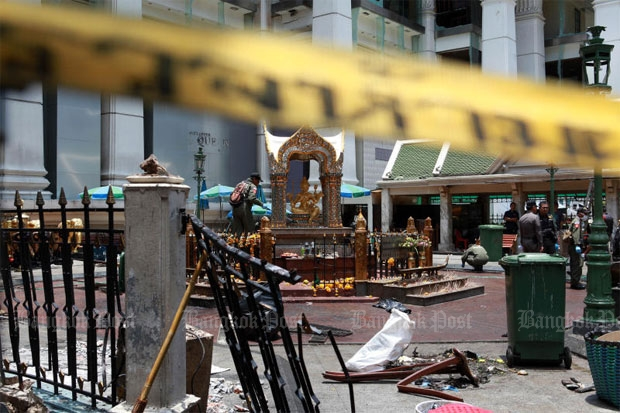 Security officers collect evidence a day after the Erawan shrine bombing, which has raised the question of whether Thailand should retain the death penalty. NATTAPOL LOVAKIJ