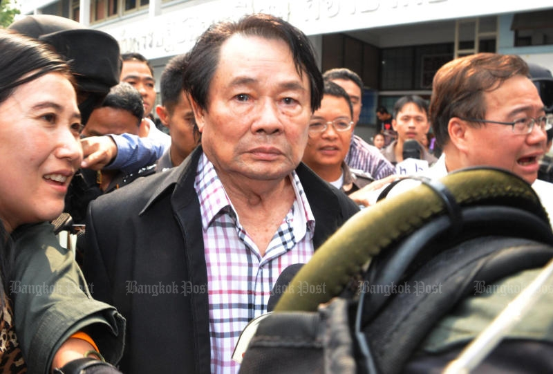 Somchai Khunploem, alias Kamnan Poh, is taken to the Crime Suppression Division following his arrest at the Lat Krabang toll gate in February 2013.(Bangkok Post file photo)