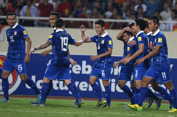 Thailand's players celebrate after scoring their third goal during a World Cup 2018 qualifier between Vietnam and Thailand on October 1 3, 2015 at Hanoi's My Dinh stadium. Thailand defeated Vietnam 3-0. AFP photos by Hoang Dinh Nam
