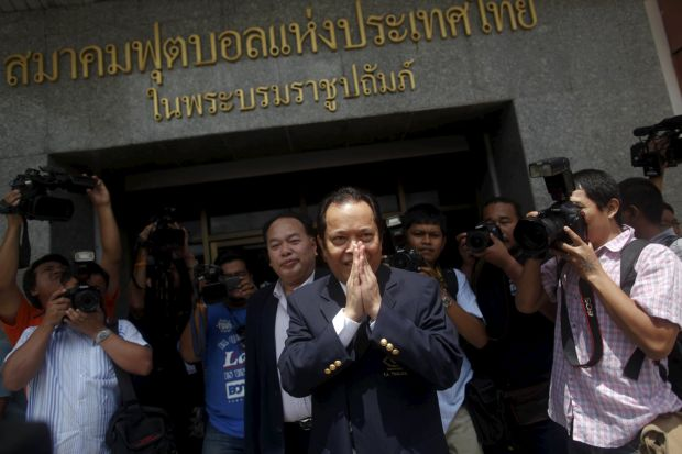 Former Fifa executive committee member Worawi Makudi greets supporters following a court hearing in Bangkok in May. (Reuters photo)