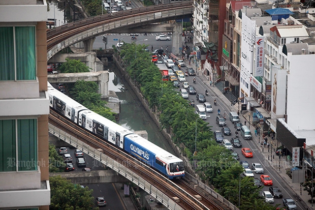 Traffic jams, street protests, bombs and floods have helped drive people to use Bangkok's mass-transit system as the city's population approaches 10 million people. (Photo by Panupong Changchai)