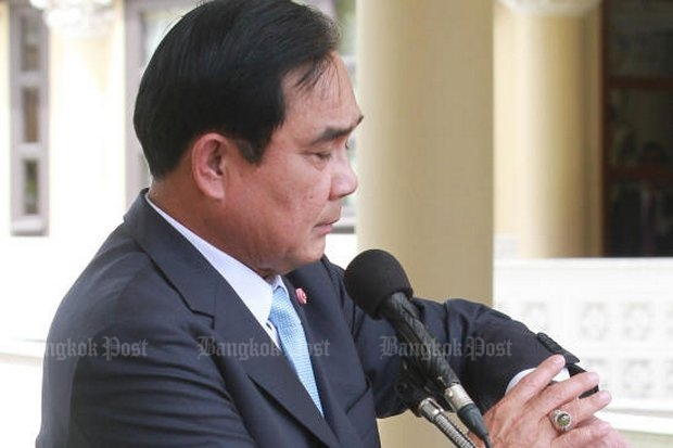 Prime Minister Prayut Chan-o-cha checked his watch Tuesday, then announced it's time for an all-out blitz on lese majeste and against those who defame the monarchy. (Photo by Thiti Wannamontha)