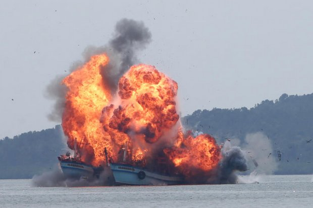 A fireball highlights the destruction of two Thai fishing trawlers by the Indonesian Navy on Tuesday. (AP photo)