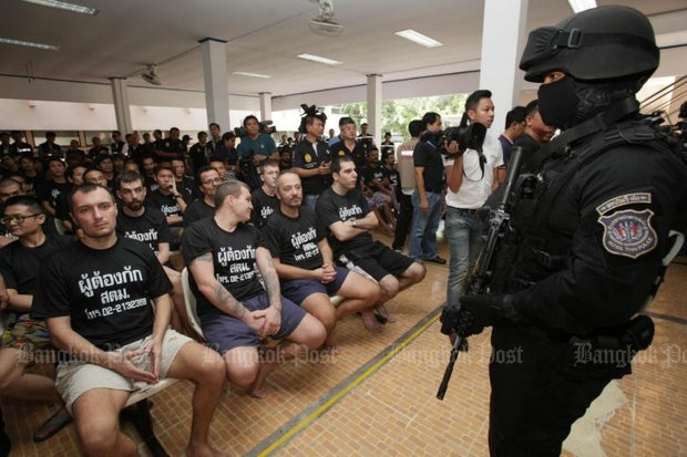 Immigration police say these are just a few of the estimated 800,000 foreigners who are in Thailand on passports and papers that have expired. (Photo by Apichit Jinakul)