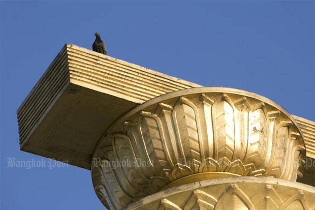 A pigeon, a symbol of press freedom for the Thai media, sits on the Democracy Monument.Krit Promsaka na Sakolnakorn