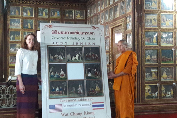 American artist Judy Jensen returns repaired paintings in Mae Hong Son province on Monday. (Photo by Cheewin Sattha)