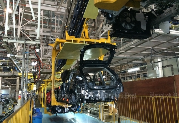 A Mazda2 eco-car moves down the line at the AutoAlliance Thailand plant, a Ford-Mazda joint venture in Rayong.