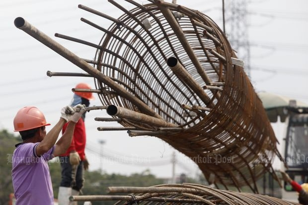 Labourers work at a construction site of the Red Line mass transit project in Bangkok in October. Infrastructure projects are expected to help boost growth next year. (File photo by Pattarapong Chatpattarasill)