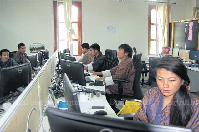 Employees of Southtech Bhutan work in their office at the Thimphu TechPark, which is home to about 600 mostly young tech workers in total.