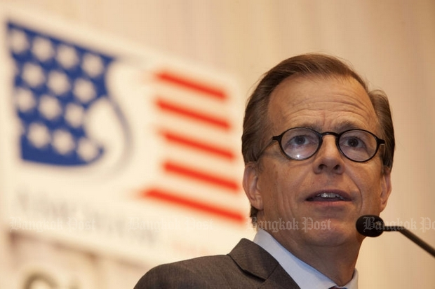 US Ambassador Glyn T Davies, seen here addressing the American Chamber of Commerce on Tuesday, told foreign media Wednesday he was concerned by prosecution and lengthy prison sentences in defamation and lese majeste cases. (Photo by Pawat Laopaisarntaksin)