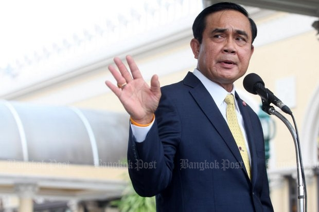 On the eve of his departure for the Paris global warming summit, Prime Minister Prayut Chan-o-cha has second thoughts on a pledge to cut emissions by 25%. (Photo by Thiti Wannamontha)
