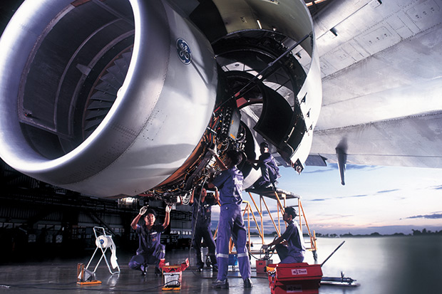 A mechanic works on a Thai Airways International jet engine at Suvarnabhumi airport in this 2006 file photo. The US Federal Aviation Administration downgraded Thailand's aviation-safety standing following a failed audit of procedures and practices. (Bangkok Post file photo)