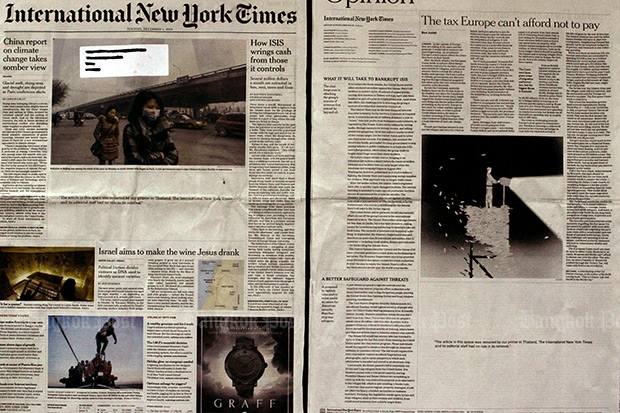 The front page of the International New York Times edition from Dec 1, and the opinion page from the Dec 4 edition, with blank spaces where stories were removed by the local printer of the Thailand edition. (Photo by Kosol Nakachon)