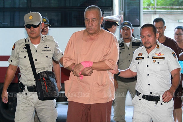 Former CIB chief Pongpat Chayapan is taken to court for a hearing on lese majeste charges in February this year. (Bangkok Post file photo)
