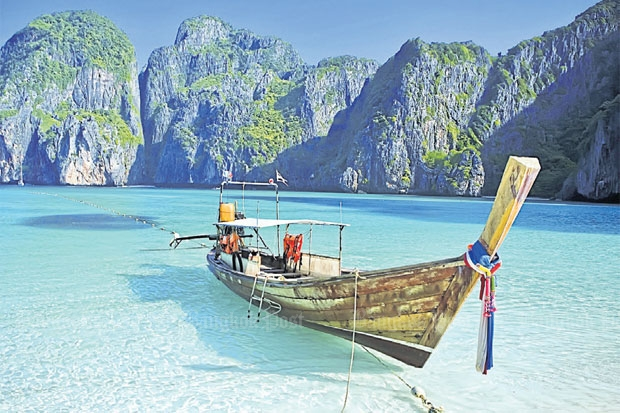 The crystal waters  and white beaches  attract tourists  to Ao Maya on  Koh Phi Phi Ley.  Experts worry  a tourism influx  and corruption  among officials  are destroying  the island group's  pristine beauty.