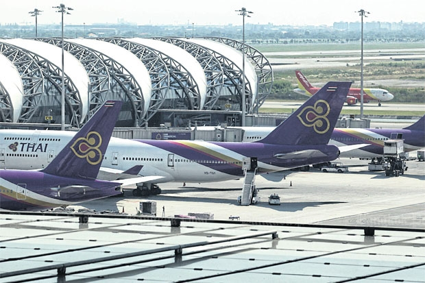 THAI aircraft are parked at Suvarnabhumi airport. THAI and MJets have received EU approval to continue flying to Europe.WICHAN CHAROENKIATPAKUL