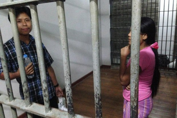 Myanmar shrimp shed worker Tin Nyo Win, left, and his wife, Mi San, were arrested in Samut Sakhon after talking about conditions in the shrimp export industry - fingerprinted, held on 140,000 baht bail, charged with entering the country illegally and working without permits. (All photos by AP)