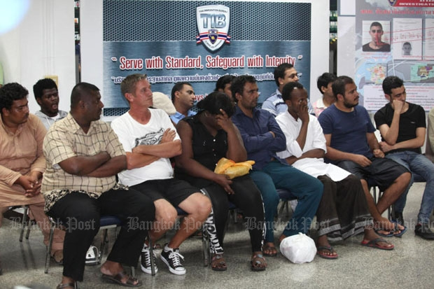The Immigration Bureau shows about 100 foreigners rounded up for overstaying visas in a news conference in Bangkok on Monday. (Photo by Wichan Charoenkiatpakul)