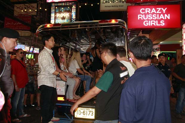Police round up go-go foreign dancers at Crazy Russian Girls bar in Pattaya's Walking Street and charge them with working without a permit early on Tuesday. (Photo by Chaiyot Phuttanapong)