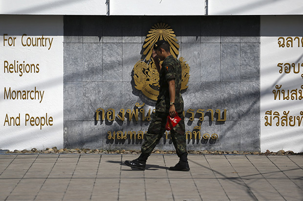 """A soldier walks outside the 11th Army Circle base in Bangkok, which rights activists now liken to Thailand's own """"black site"""" to detain suspects in a range of crimes deemed to be against national security. (Reuters photo)"""