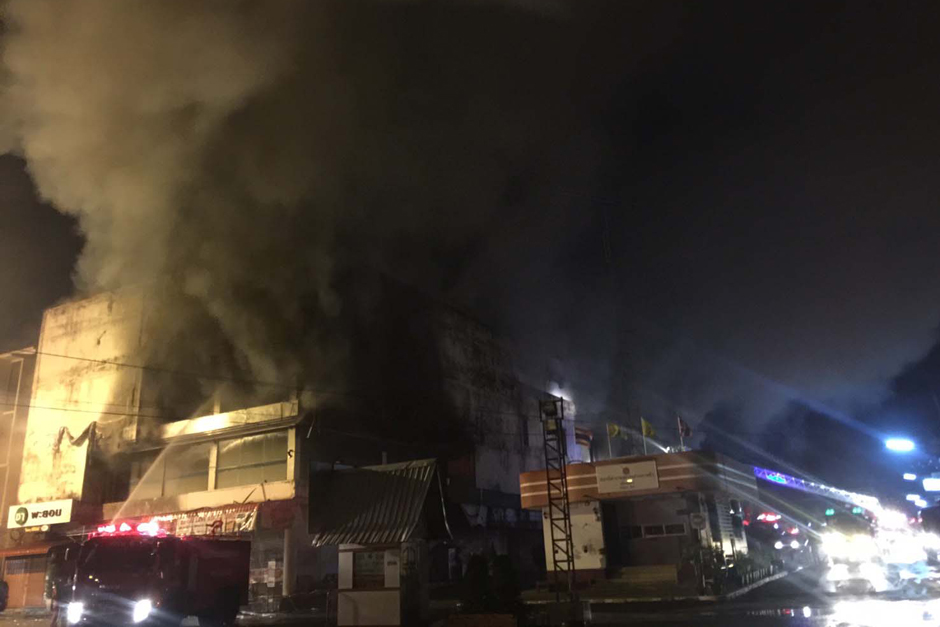 A fire causes major damage at a local department store in Trang. - Methee Muangkaew