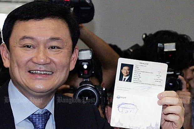 Flashback 2005: Then prime minister, Thaksin showed off a new passport to the media. (File photo)