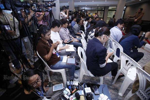 Reporters cover news at Government House as the Constitution Drafting Committee plans to authorise the government to censor news reports during emergency situations. (Photo by Thanarak Khunton)