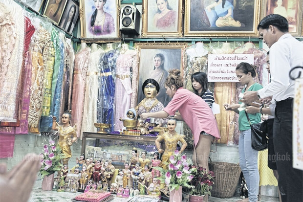 Popular: People visit the shrine to 'Mae Nak', one of Bangkok's most famous ghosts, two days before a lottery draw to pray for luck.