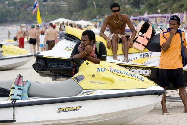 Jet ski operators wait for customers at Patong Beach. Officials are promising yet again to try to prevent cheating of jet ski renters, arguably the best-known tourist scam. (AP file photo)