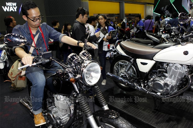 A visitor tries a big bike at a recent motor show in Bangkok. BMW Motorrad Thailand says most Thai bikers want to own a second motorcycle, so the market will remain lucrative. THANARAK KHUNTON