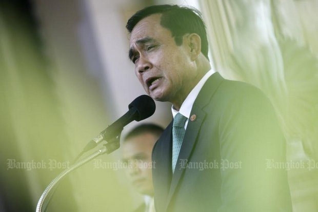 Prime Minister Prayut Chan-o-cha and his National Council for Peace and Order (NCPO) are firmly in control, but the outlook is hazy as pressure now begins to build over the glum constitutional outlook. (Photo by Thanarak Khunton)