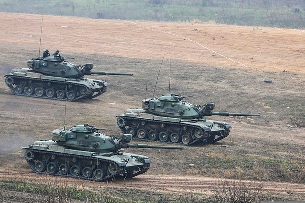 US-made M60 tanks manoeuvre during war games at Ban Chan Krem, two years ago. First deployed 40 years ago, the M60s are still in service. (Photo via Wikipedia, Creative Commons licence)