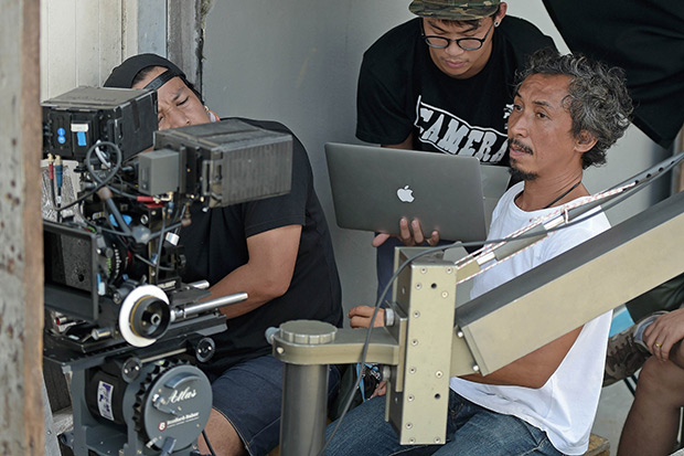 Crew members working on the set of the shooting of a sequence of an advert for a Thai bank promoting a scholarship fund in November. (AFP photo)