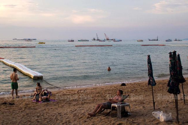 Sunbathers and swimmers enjoy a party-sunny day on Pattaya Beach on Nov 25. Pattaya is a top destination for Russians coming to Thailand. (Photo by Bob James)