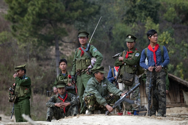 Soldiers of the Ta'ang National Liberation Army (TNLA), a Palaung ethnic armed group, stand guard outside a village in Mantong township in Shan State. (AP Photo)