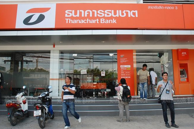 Canada's Scotiabank plans to sell its 49% share in Thanachart Bank, Thailand's biggest automobile lender. (Photo by Pongpat Wongyala)