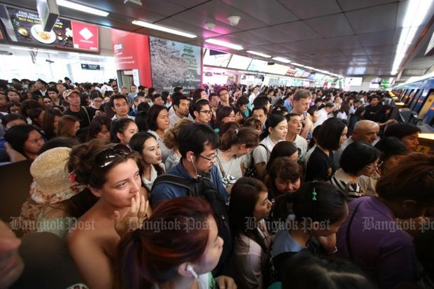 A small part of one crowd queues for the BTS skytrain at Mor Chit station Wednesday as