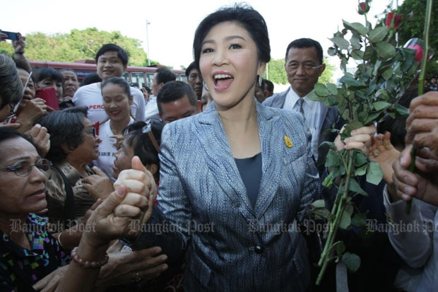 Former prime minister Yingluck Shinawatra meets supporters at the Supreme Court on Friday as she attends the third day of prosecution witness testimony in her trial for negligence related to her government's rice-pledging programme. (Photo by Apichit Jinakul)