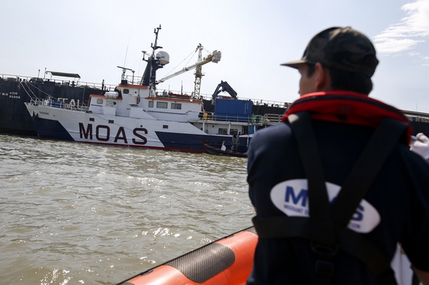 A Migrant Offshore Aid Station (MOAS) crew member steers a launch toward the mother ship MV Phoenix in the Chao Phraya river in Samut Prakan east of Bangkok. The group is preparing for a mission in the Andaman sea to track and rescue refugee boats. (Reuters Photo)