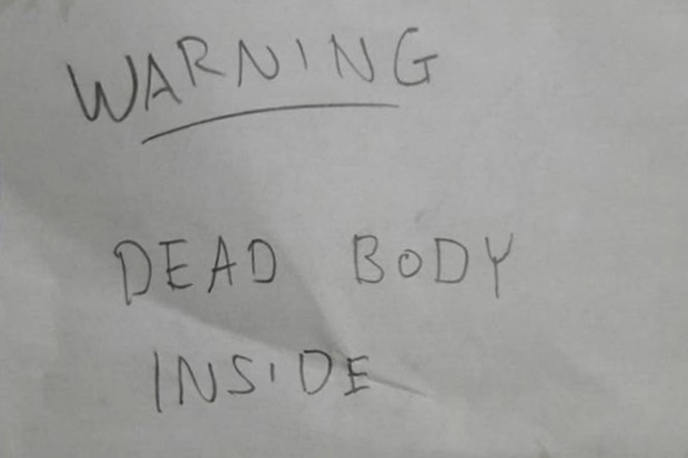 A note is found at the hotel in Pattaya where a Singaporean committed suicide on Tuesday. (Photo by Chaiyot Phupattanapong)