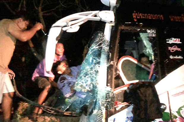 Injured students are pulled from the wreckage of a bus struck by a pickup truck in Kalasin early Wednesday. (Photo by Yongyut Phupuangphet)