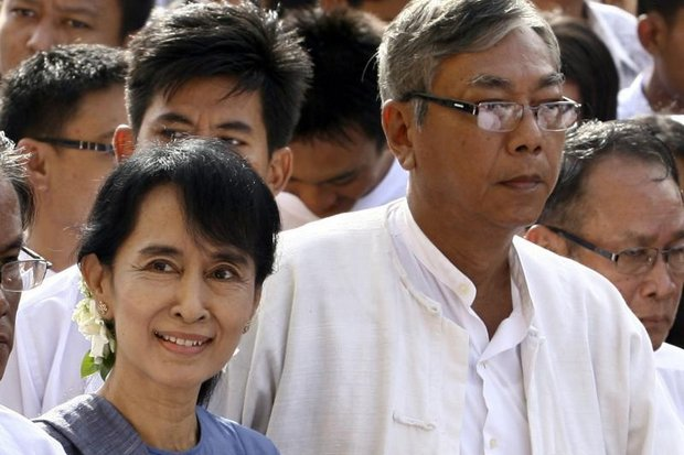 Loyalist and Oxford graduate Htin Kyaw (right) will serve Aung San Suu Kyi as president or vice-president, allowing her to pull Myanmar's strings behind the scenes. (EPA photo)