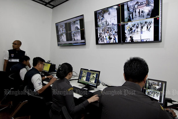 Immigration police in a control room at Suvarnabhumi airport monitor their screens as a passenger background check system known as the Advance Passenger Processing System was launched on Dec 1, 2015. (Photo by Krit Promsaka na Sakolnakorn)